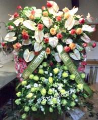 Corona funeraria de rosas